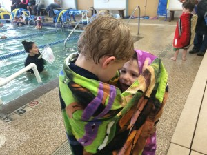 Brecken telling Madiana how good she did at swimming