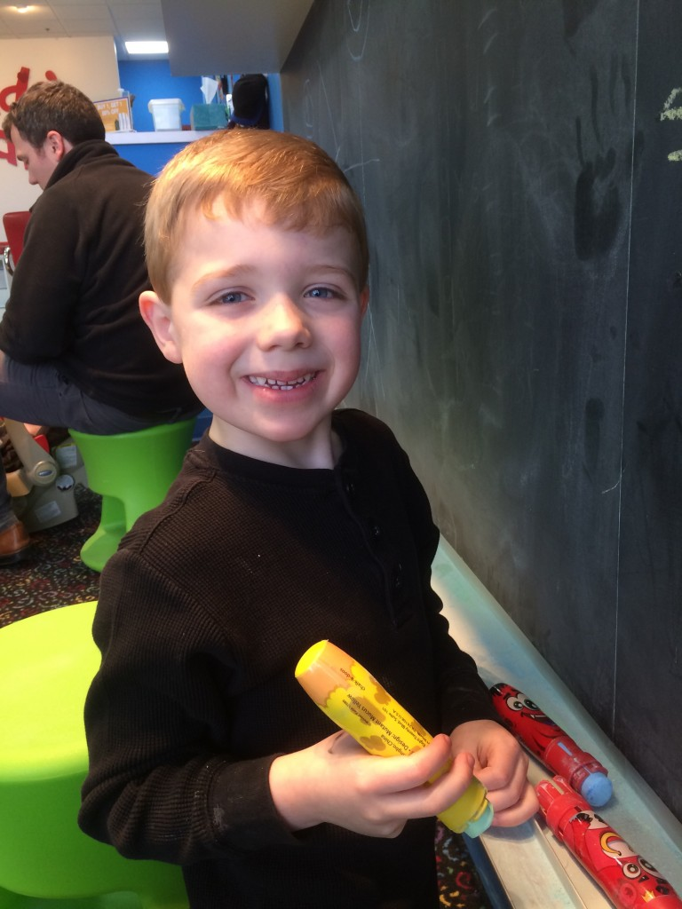 Brecken was excited to write on the chalkboard after his haircut.