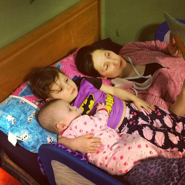 Gretchen, Madiana, and April reading books together