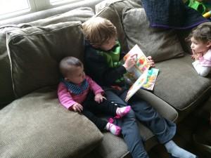 Brecken reading books to Gretchen