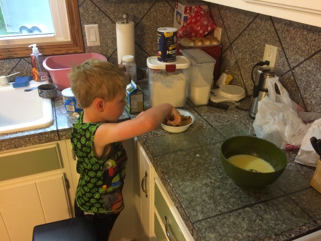 Brecken helping making breakfast in bed for April
