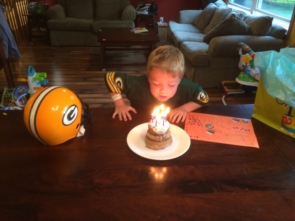 Brecken blowing out the candles.